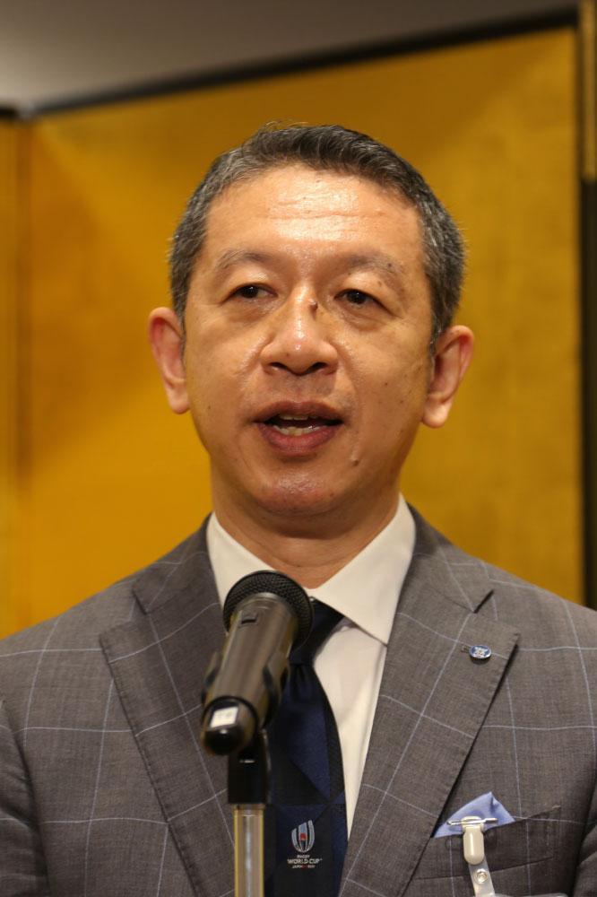 あいさつする加藤義竹・新潟産業人クラブ会長.jpg